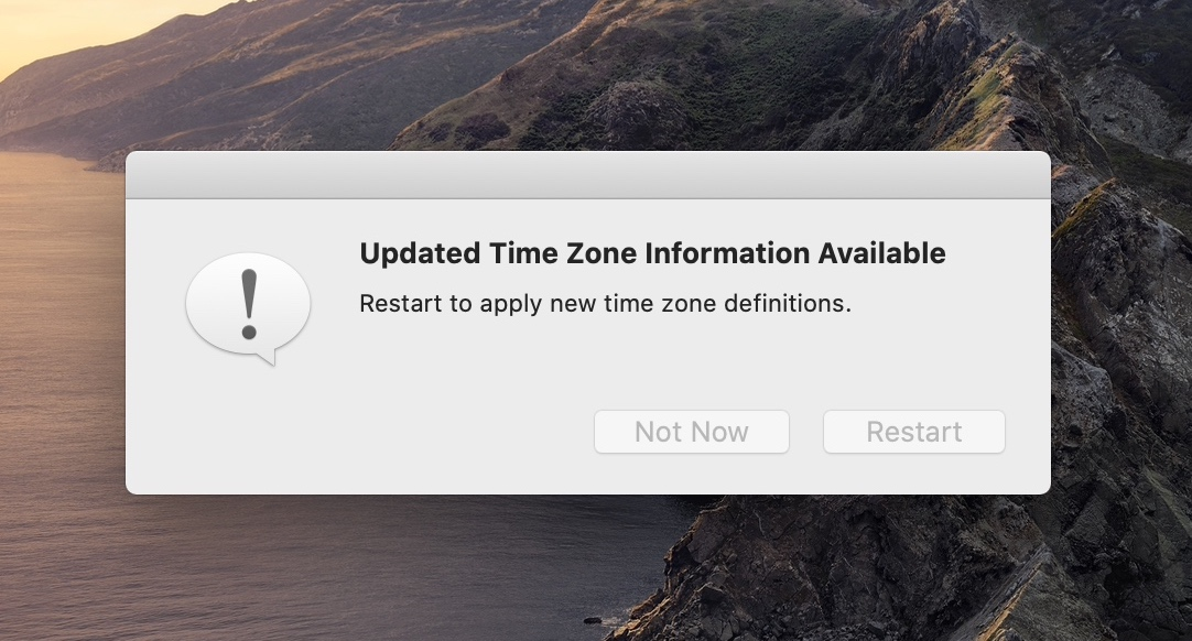 "A screenshot of a MacOS dialog message that says: ""Updated Time Zone Information Available. Restart to apply new time zone definitions."""